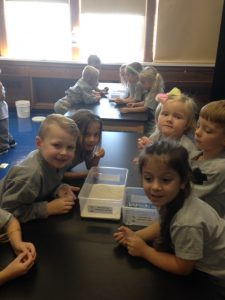 Kindergartens recreating the surface of the moon with sand